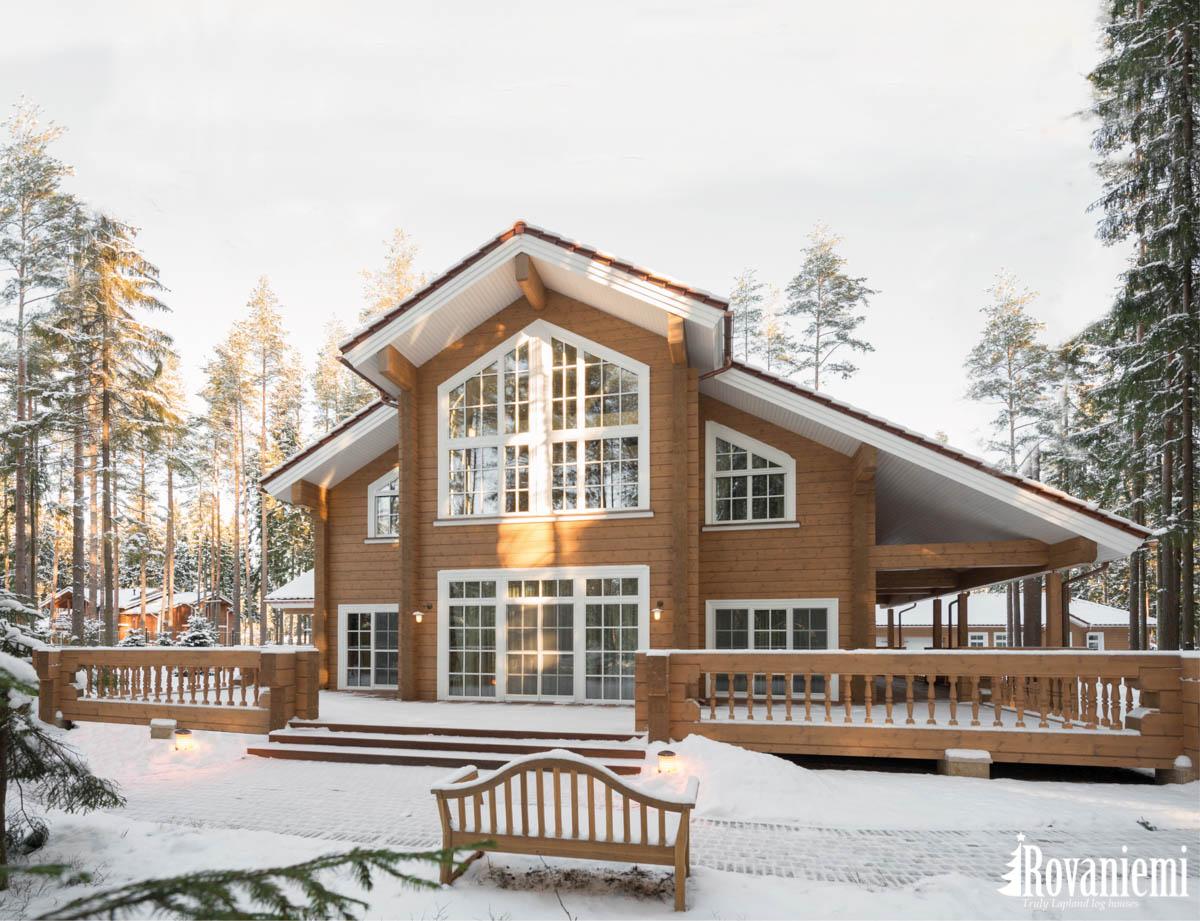 Bedroom inside 'Helios' wooden cottage by Rovaniemi