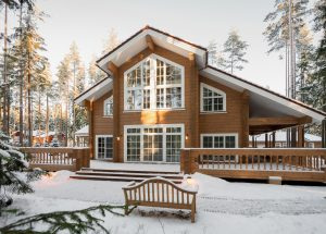 Finnish modern log home made of laminated logs provided by Aito Log Houses