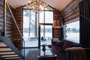 Round log home made of kelo located in Swedish Lapland and provided by Aito