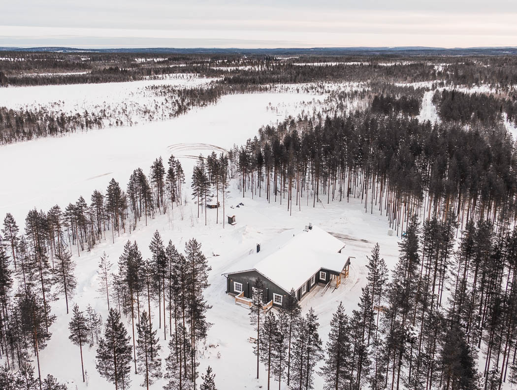 Wooden chalet in the winter wonderland of Rovaniemi Lapland Finland.