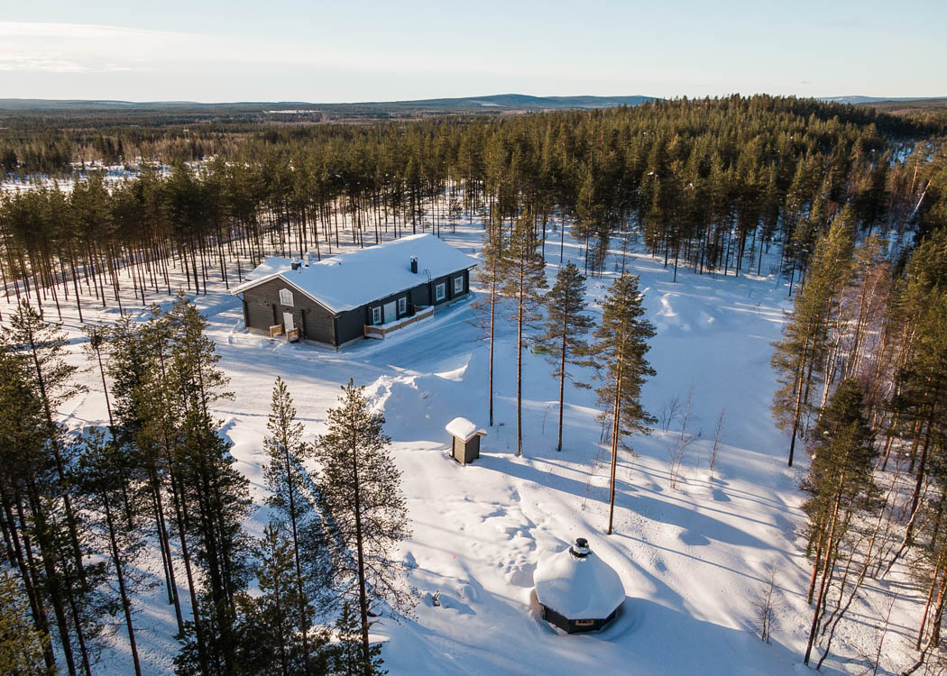 Aerial view of a safari house produced by Rovaniemi Log House in Lapland Finland.