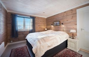 A cozy bedroom of a Aito Log House: quality living in log homes